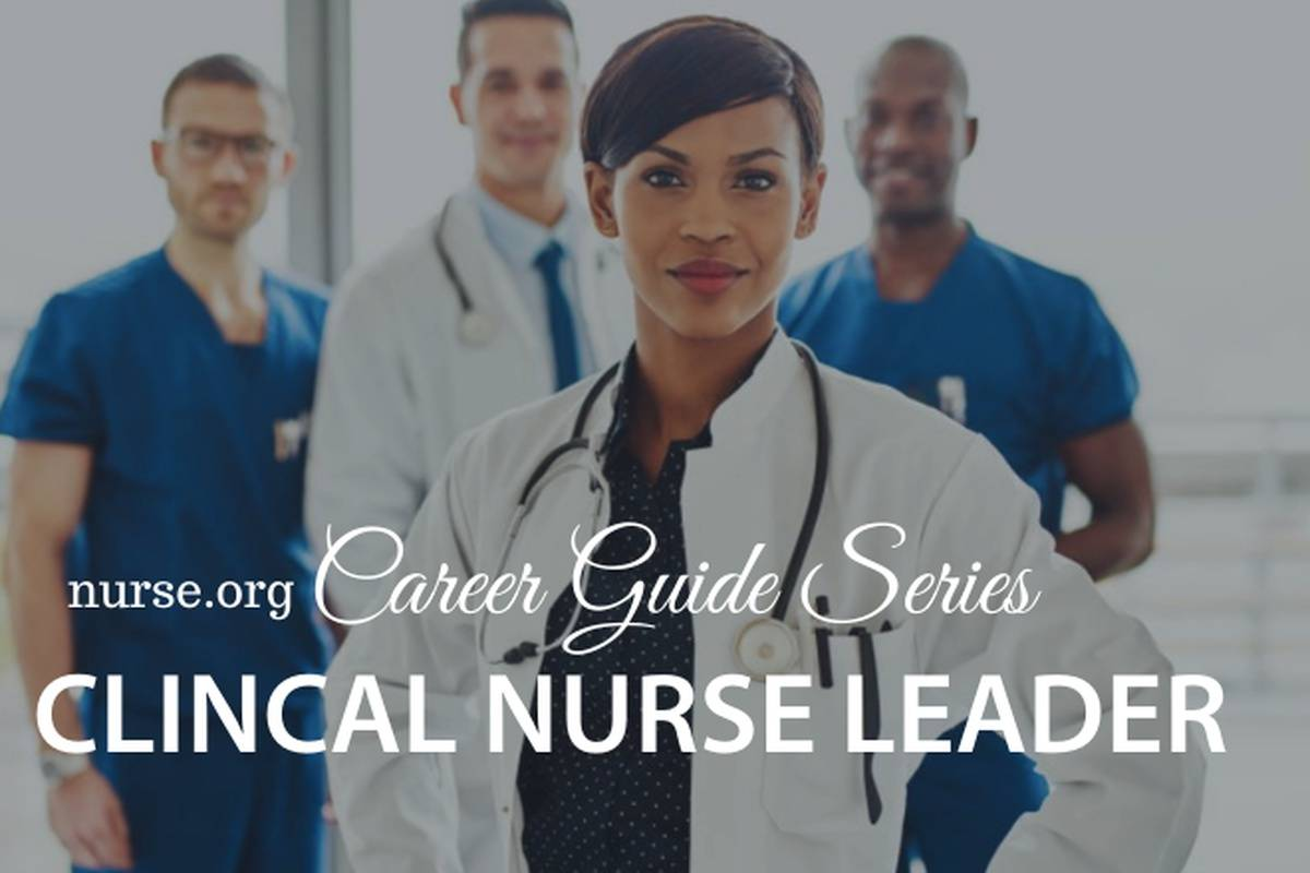 Female healthcare professional in front of nurses and doctor