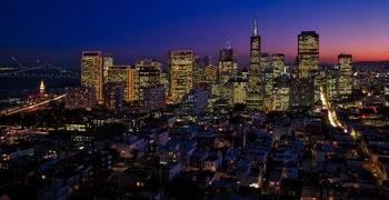 Vast Los Angeles skyline at dusk with traffic flowing