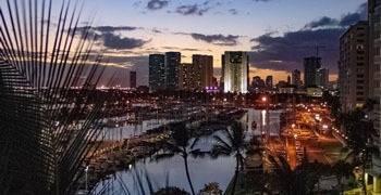 Sunset in Hawaii with city skyline of Honolulu