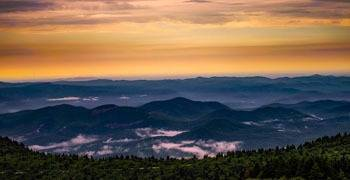 Sweeping view of multiple North Carolina cities from the mountains
