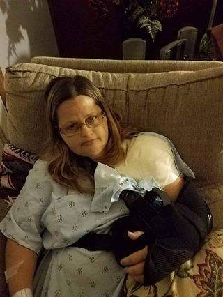 Nurse with injured shoulder resting on couch