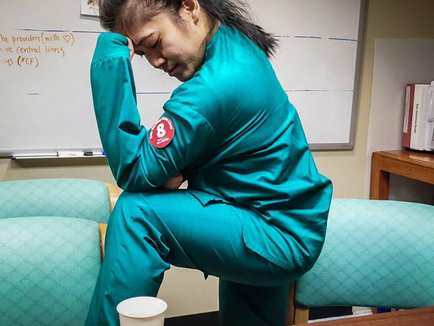 Nurse kneeling in protest
