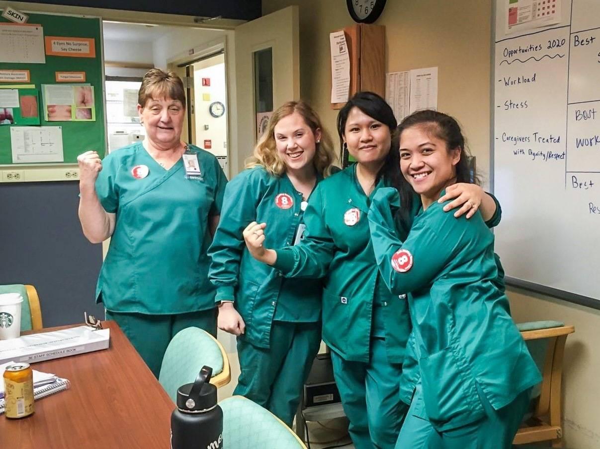 Group of nurses in solidarity in break room