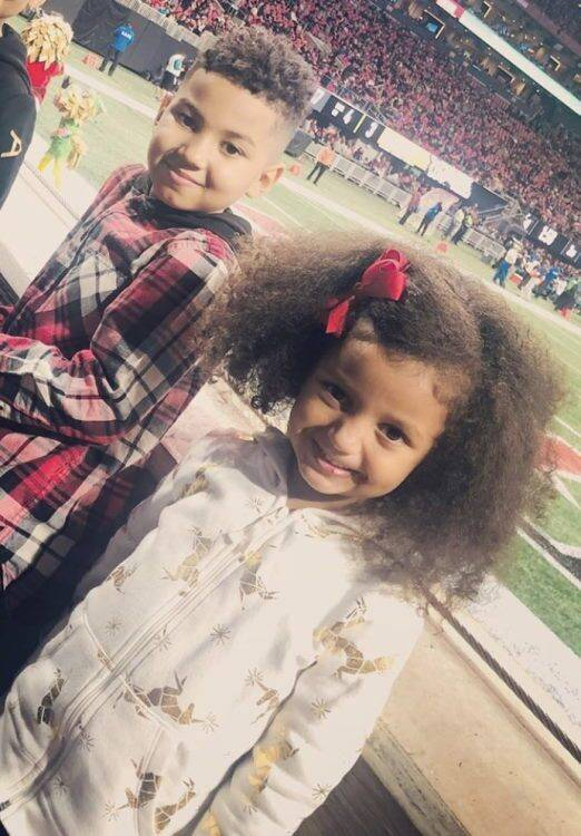 Two children smiling at football game