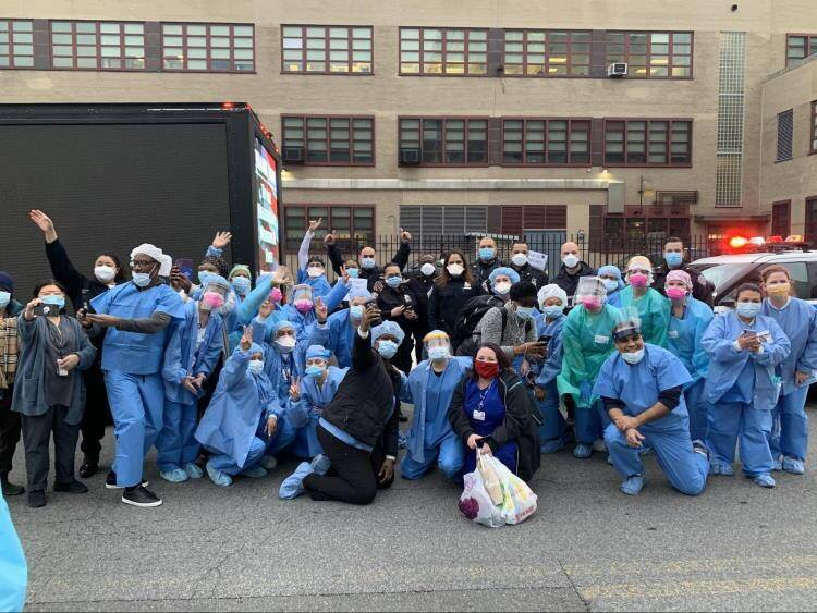 Group of nurses outside in nyc wearing ppe