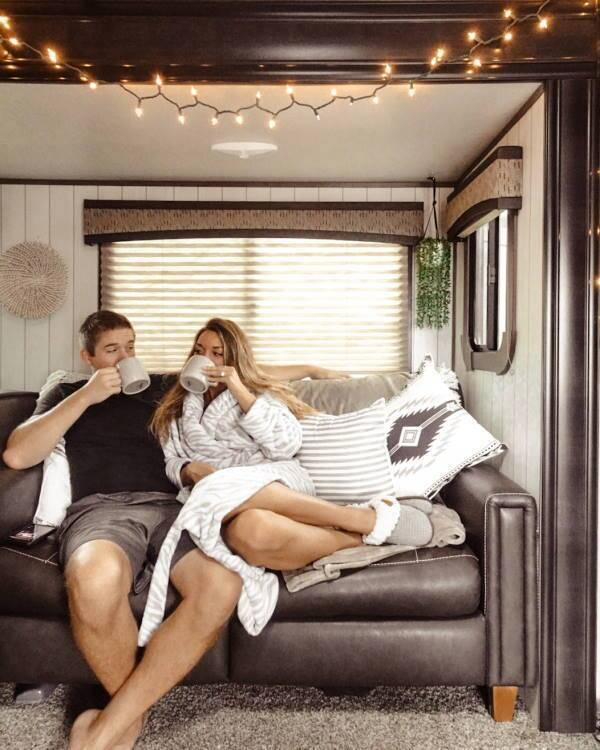 Couple sitting on couch in RV