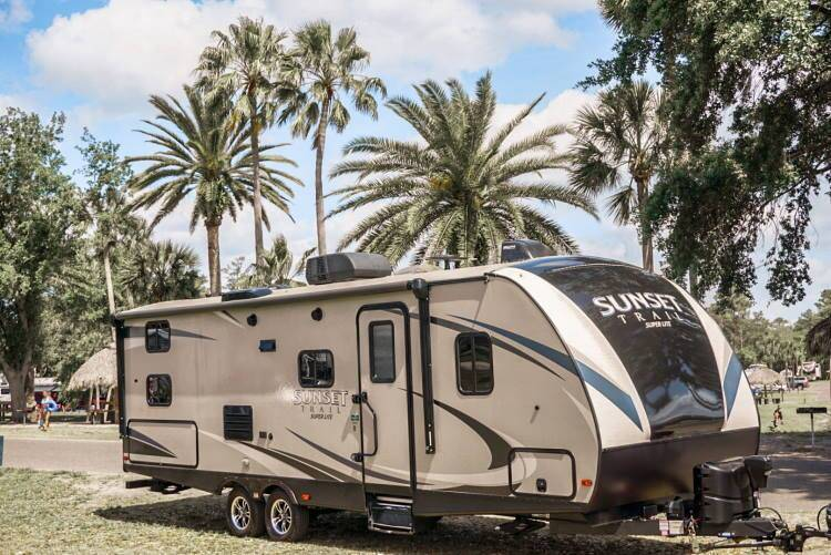 RV in front of palm trees