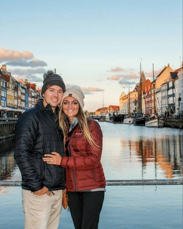 Nursing couple posing on bridge in Amsterdam